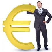 Businessman near big euro sign