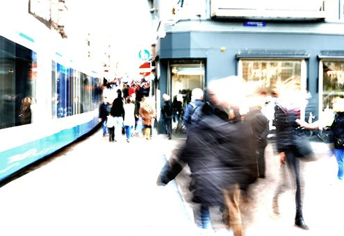 people and tram motion blur